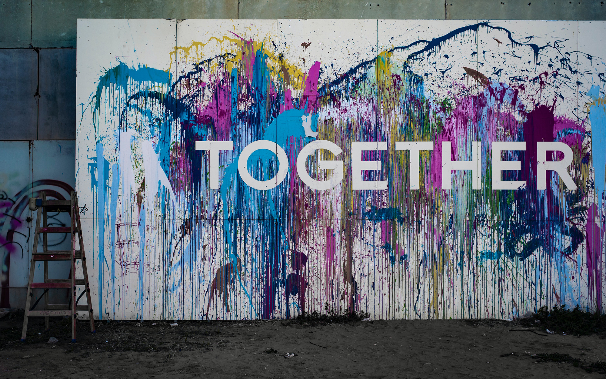 Together, written on a mural.